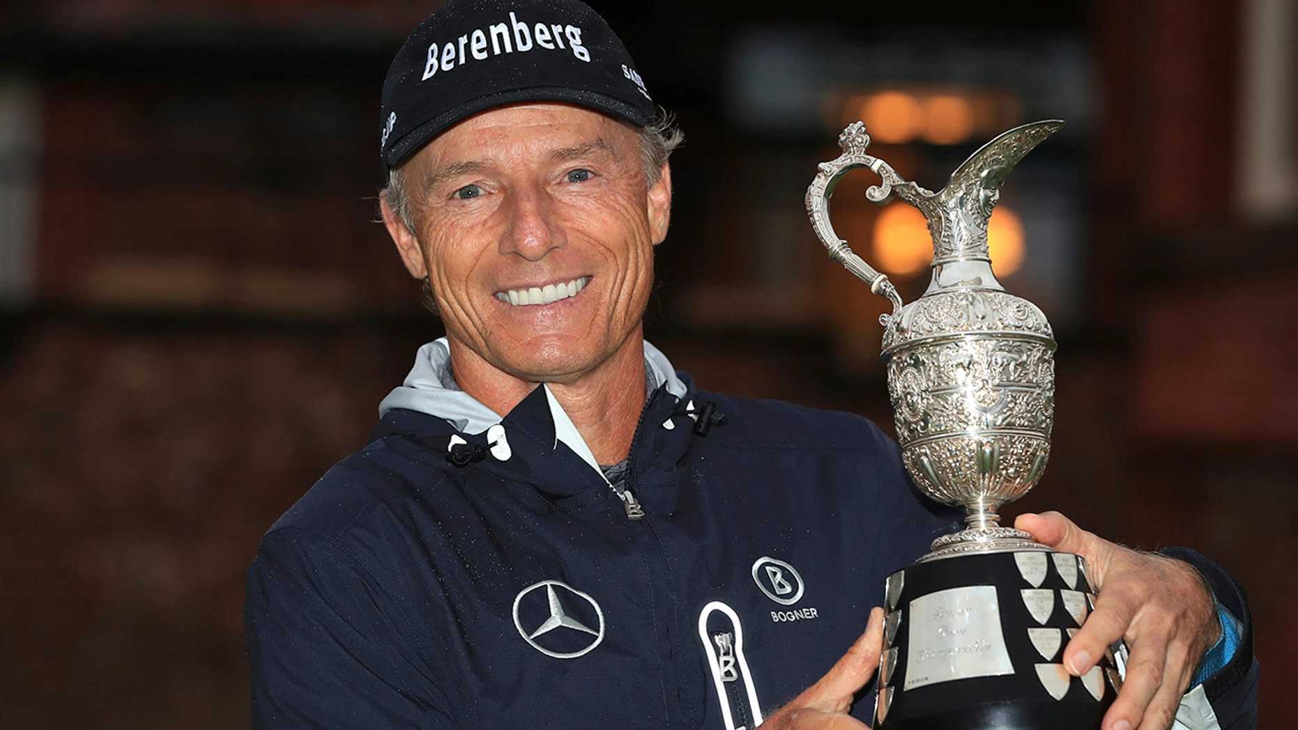 Bernhard Langer poses with the trophy after winning the senior Open golf tournament at Royal Lytham & St Annes Golf Club, in Lytham, England, Sunday July 28, 2019. (Peter Byrne/PA via AP)