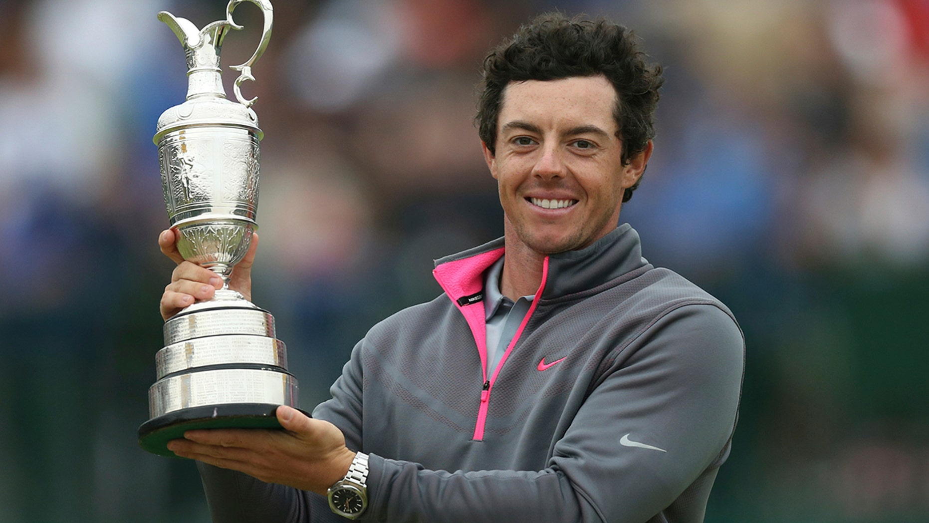 FILE - In this Sunday, July 20, 2014, file photo, Rory McIlroy of Northern Ireland holds up the Claret Jug trophy after winning the British Open Golf championship at the Royal Liverpool in Hoylake, England. McIlroy is among the favorites to win the British Open when it returns to Northern Ireland for the first time in 68 years. (AP Photo/Scott Heppell, File)