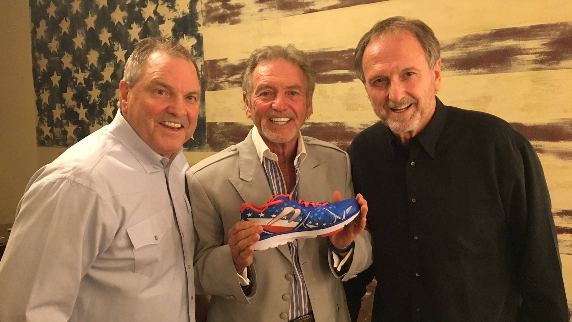 (L-R) Steve, Larry and Rudy Gatlin with their new sneaker.
