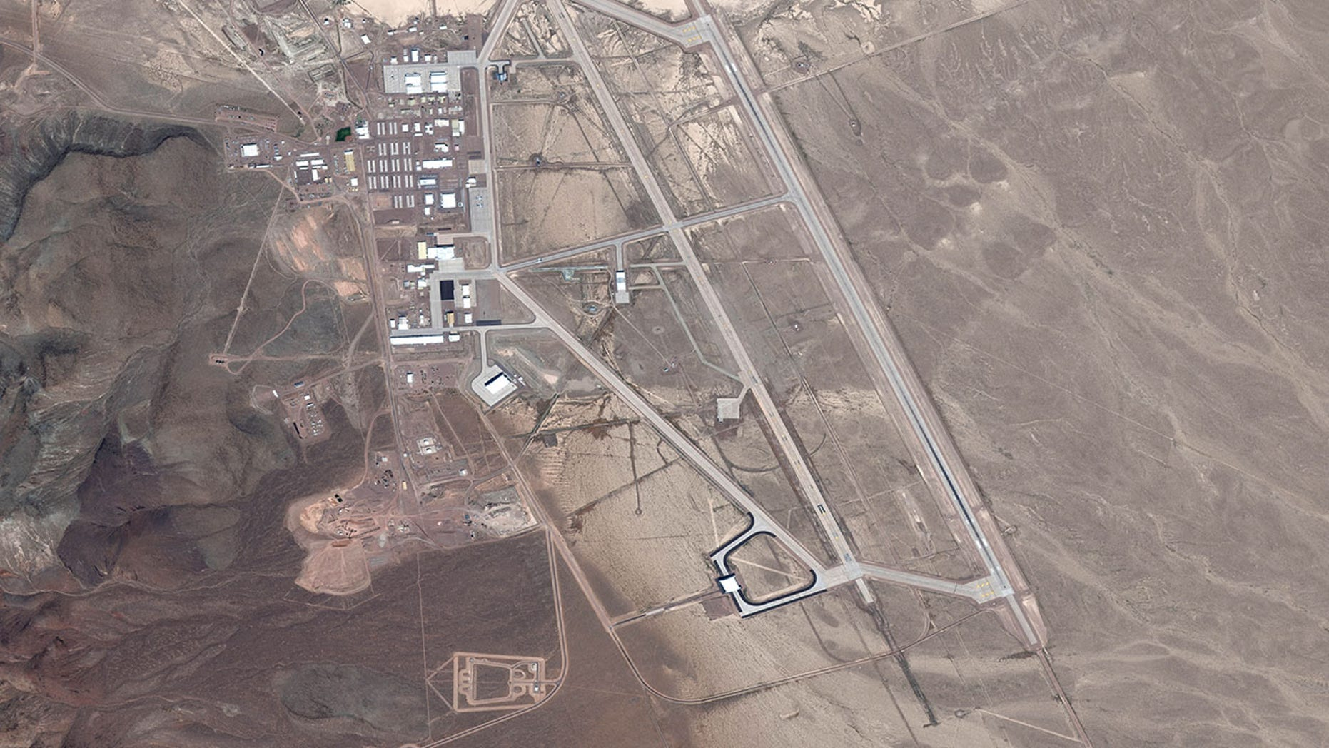 AREA 51, NEVADA, USA, JULY 20, 2016: DigitalGlobe satellite picture Area 51. The United States Air Force trickery ordinarily famous as Area 51 is a remote unconcern of Edwards Air Force Base, within a Nevada Test and Training Range. (Photo DigitalGlobe around Getty Images)