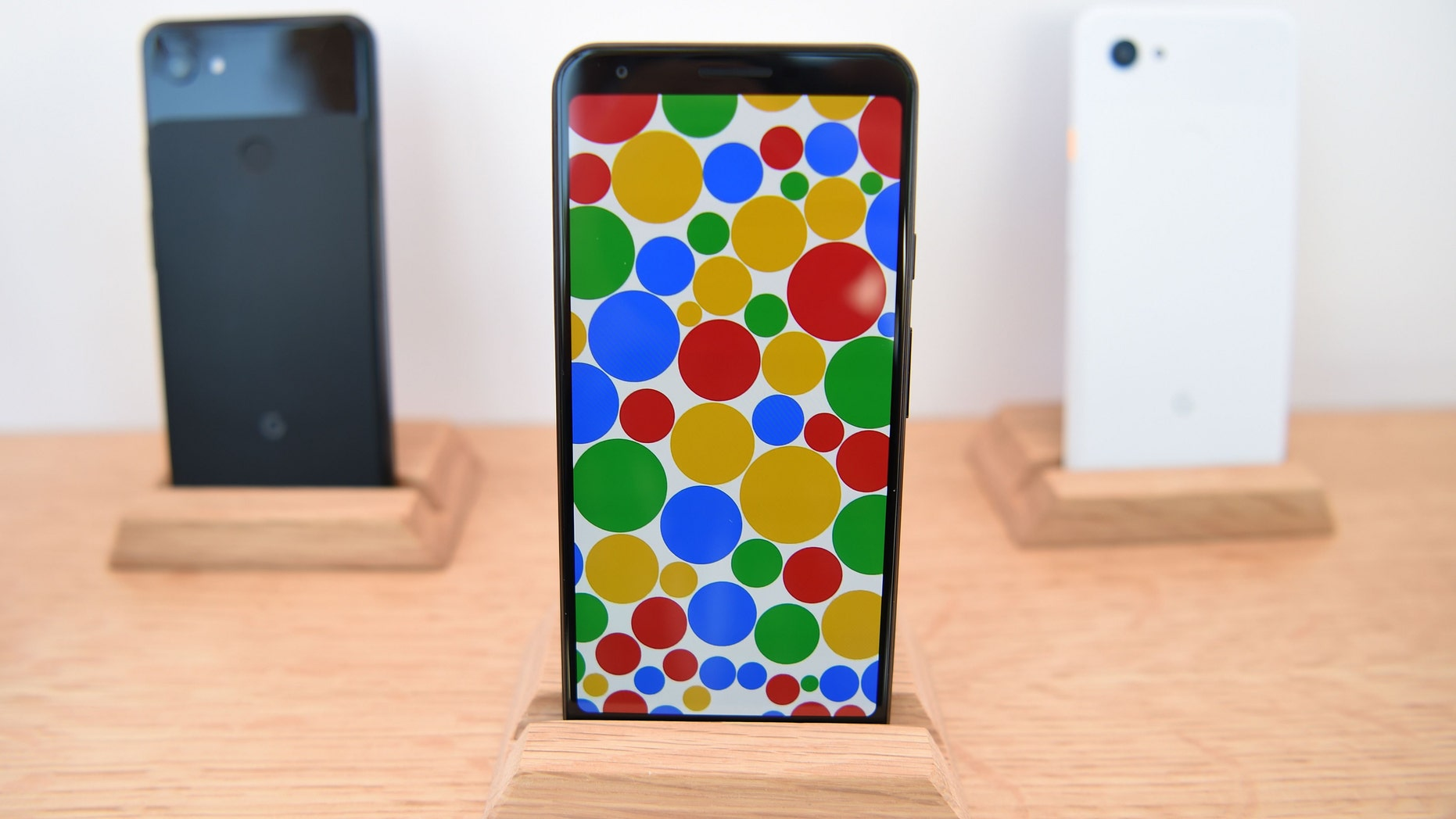 File photo - A Google Pixel 3a phone (C) is displayed during the Google I/O conference at Shoreline Amphitheatre in Mountain View, California on May 7, 2019.