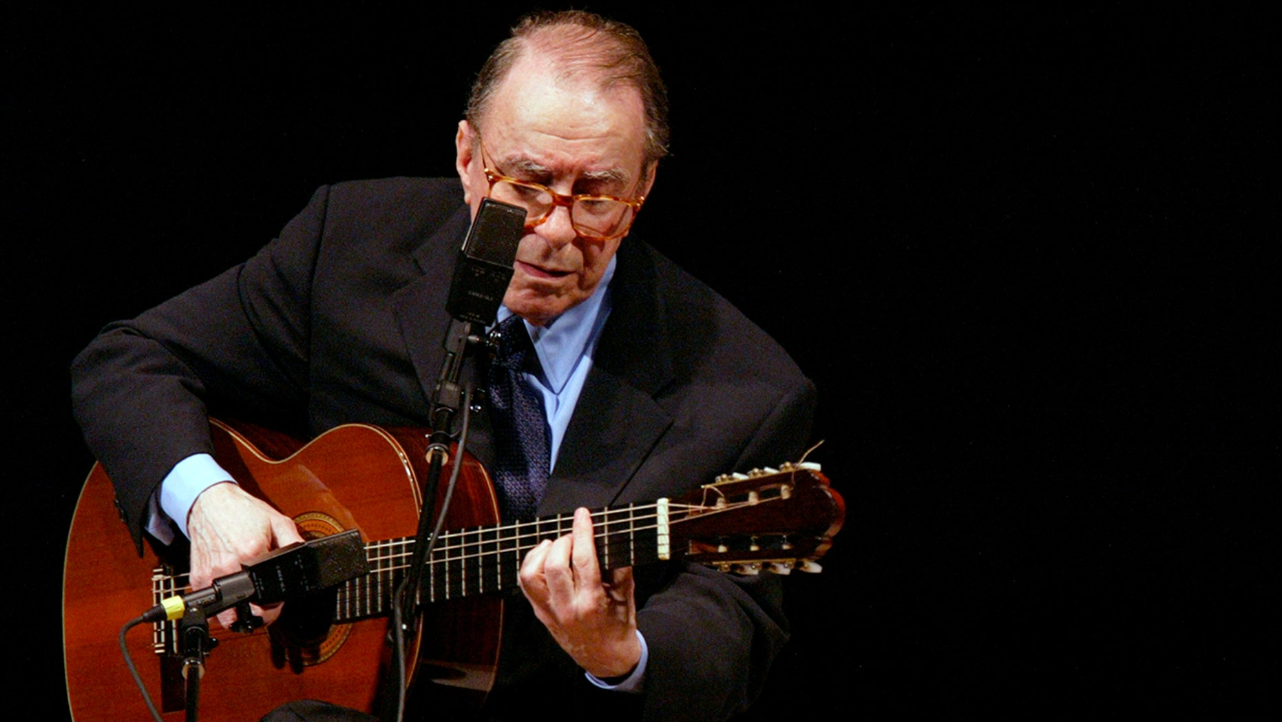 In this June 18, 2004 file photo, Brazilian composer Joao Gilberto performs at Carnegie Hall, in New York. (AP Photo/Mary Altaffer, File)