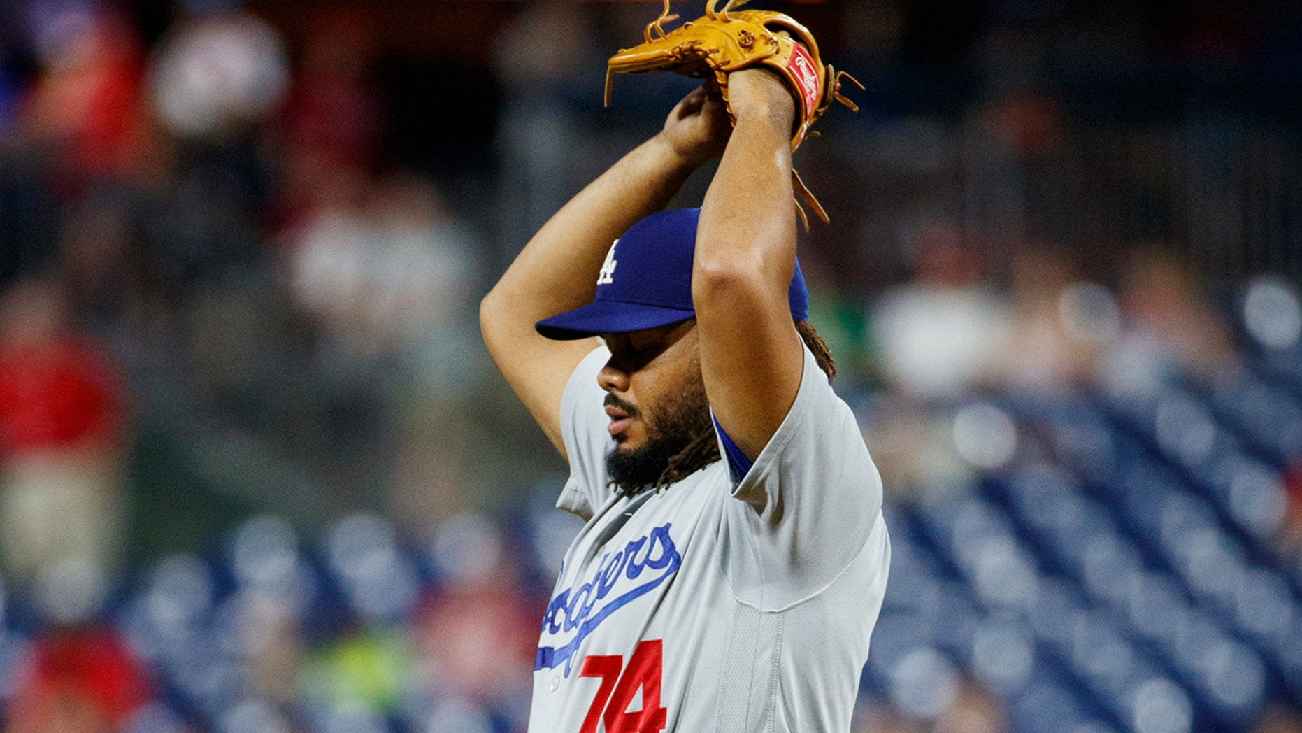 Los Angeles Dodgers relief pitcher Kenley Jansen stretches during the ninth inning of the team's baseball game against the Philadelphia Phillies, Tuesday, July 16, 2019, in Philadelphia. Philadelphia won 9-8. (AP Photo/Matt Slocum)