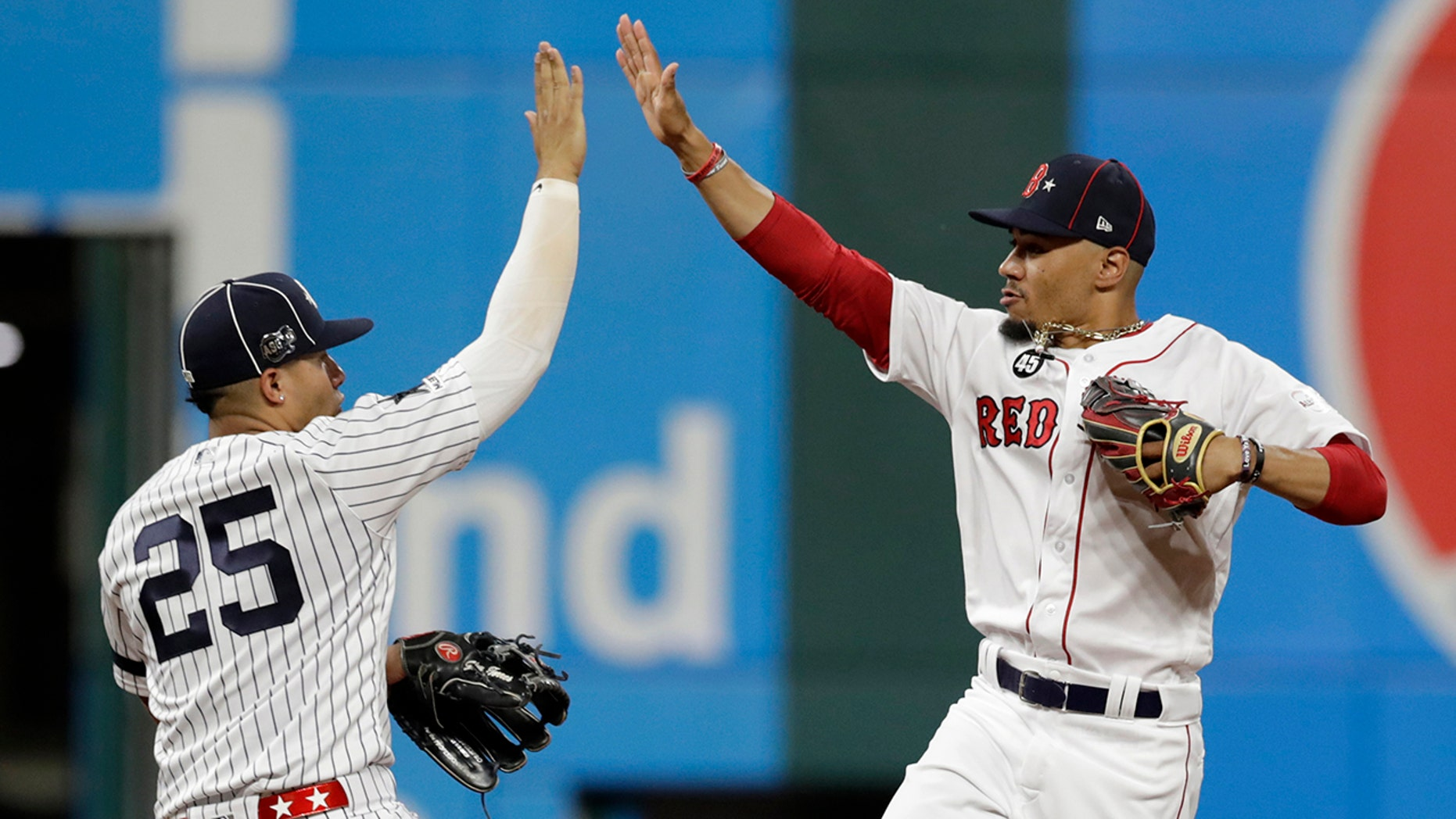 American League Gleyber Torres, left, of a New York Yankees, and American League Mookie Betts, of a Boston Red Sox, applaud a 4-3 feat of a National League in a MLB ball All-Star Game, Tuesday, Jul 9, 2019, in Cleveland. (AP Photo/Tony Dejak)