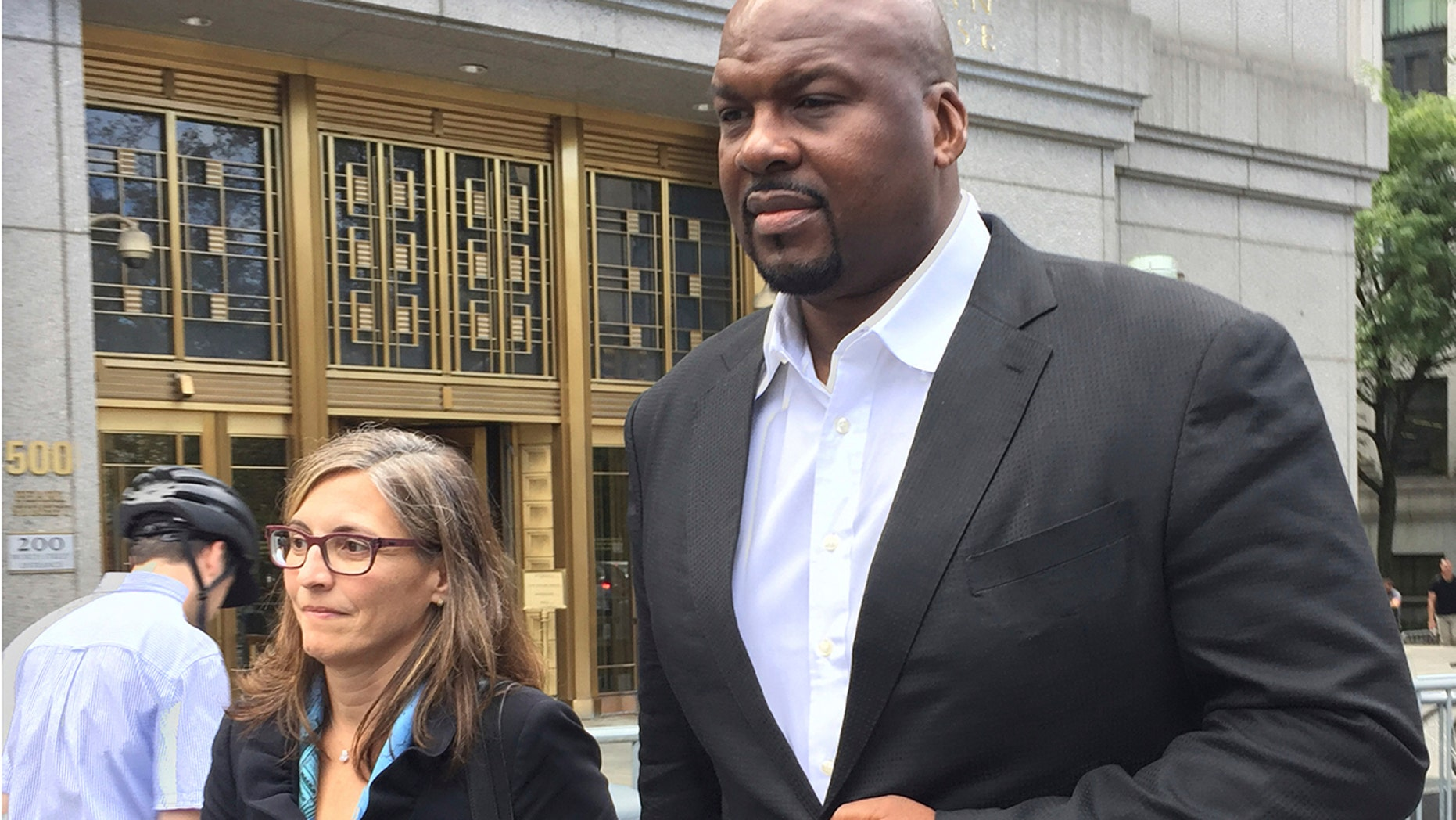 FILE - In this Oct. 10, 2017 file photo Chuck Person leaves Manhattan federal court in New York, after an initial appearance before a magistrate judge. Lawyers for the former Auburn University assistant basketball coach say the 13-year NBA veteran was broke and financially desperate when he joined a bribery conspiracy that cheated young athletes. They asked a judge in papers filed Tuesday, July 2, 2019 in Manhattan federal court to spare him from prison in the scandal that touched some of the biggest schools in college basketball. (AP Photo/Larry Neumeister, File)