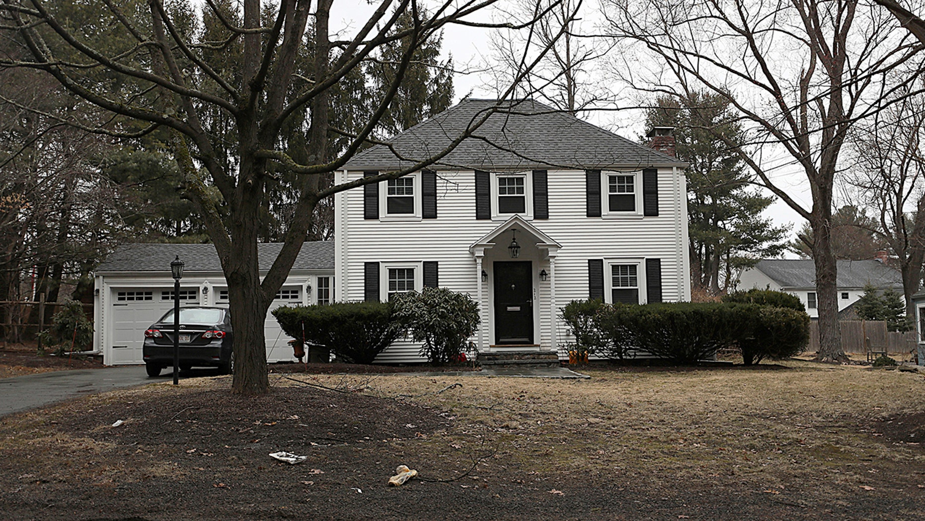 FILE -- In this Mar 20, 2019 record print a home that once belonged to Peter Brand sits among trees, in Needham, Mass. Harvard University has dismissed Brand, a longtime fencing coach, over a sale of his suburban Boston home to a rich businessman whose teenage son was after certified to a propagandize and assimilated a team. (Suzanne Kreiter/The Boston Globe around AP, File)