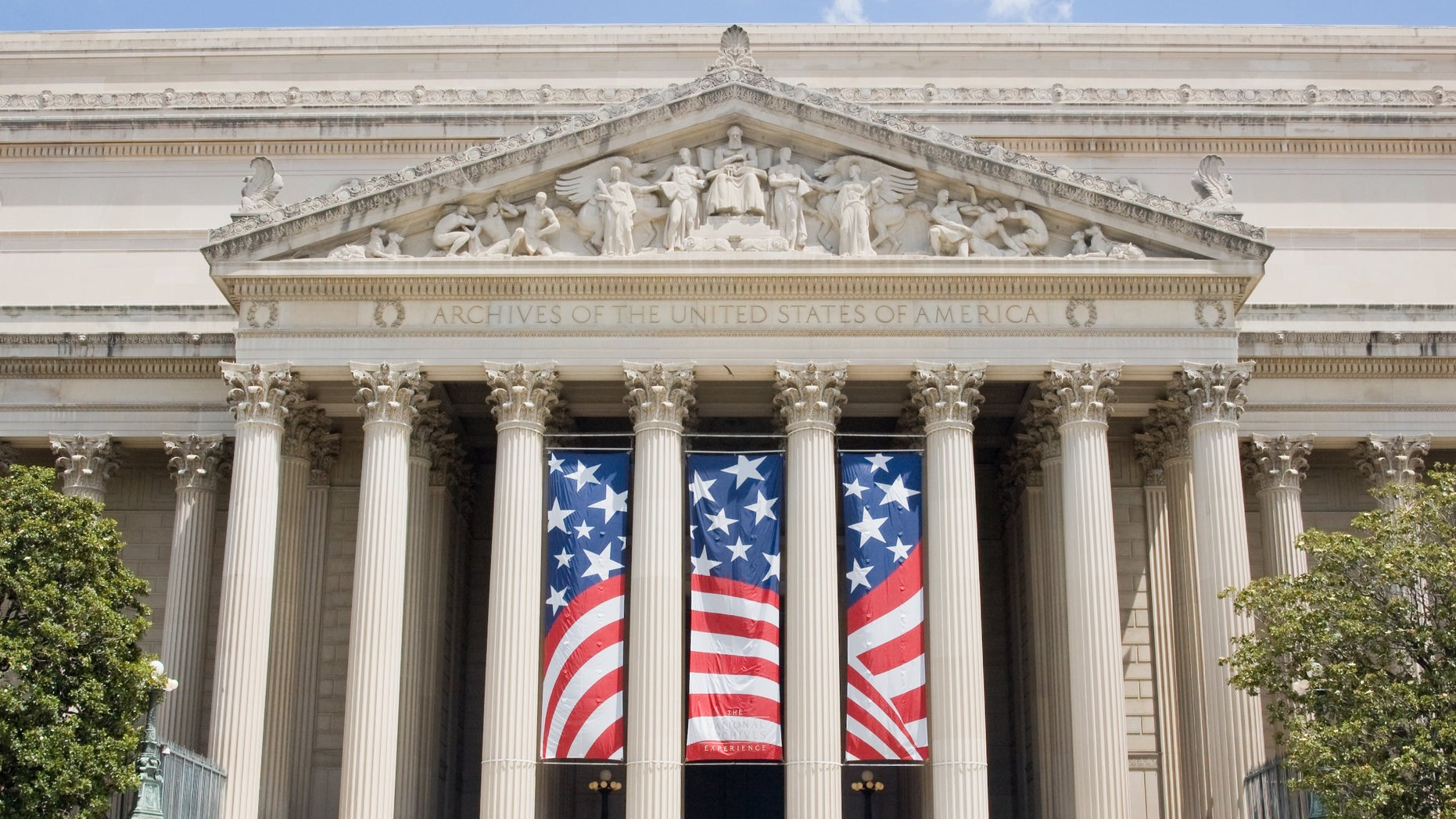 United States National Archives in Washington, DC with a outrageous dwindle unresolved on a columns.