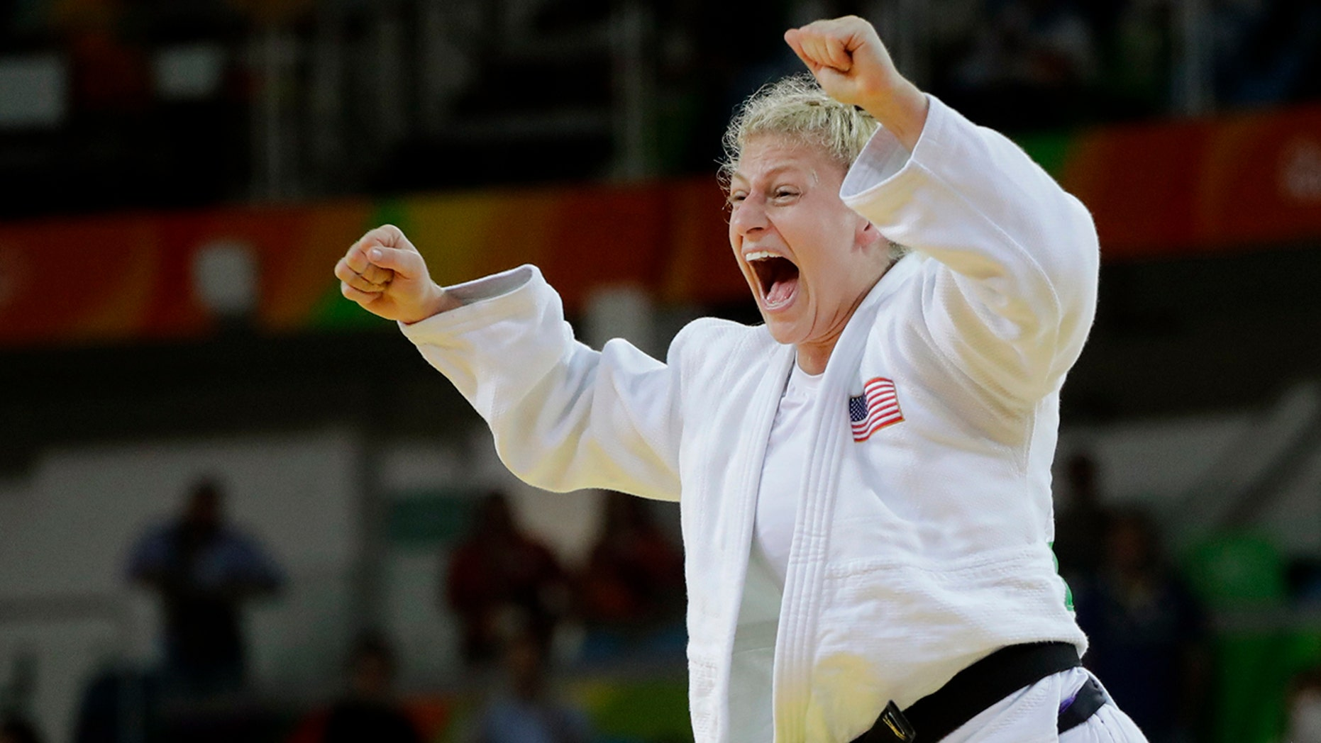 FILE - In this Thursday, Aug. 11, 2016, file photo, United States' Kayla Harrison celebrates after defeating France's Audrey Tcheumeo in the women's 78-kg judo gold medal match at the 2016 Summer Olympics in Rio de Janeiro, Brazil. Harrison improved to 5-0 in her short MMA career, Thursday, July 11, 2019, in Atlantic City, N.J., and remains in the hunt to win $1 million as PFL's lightweight champion. Harrison made Morgan Frier tap out in the first round of their fight on the PFL4 card. (AP Photo/Jae C. Hong, File)