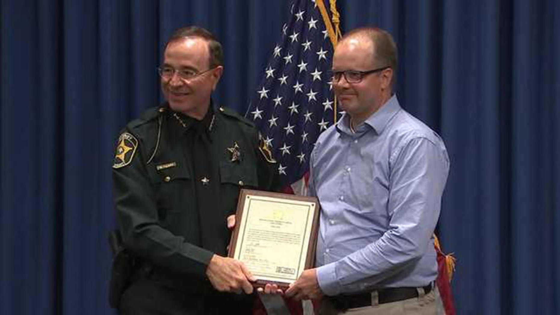 Ryan Petty, right, the father of a Parkland shooting victim Alaina Petty, became an honorary armed school guardian Thursday in Polk County.