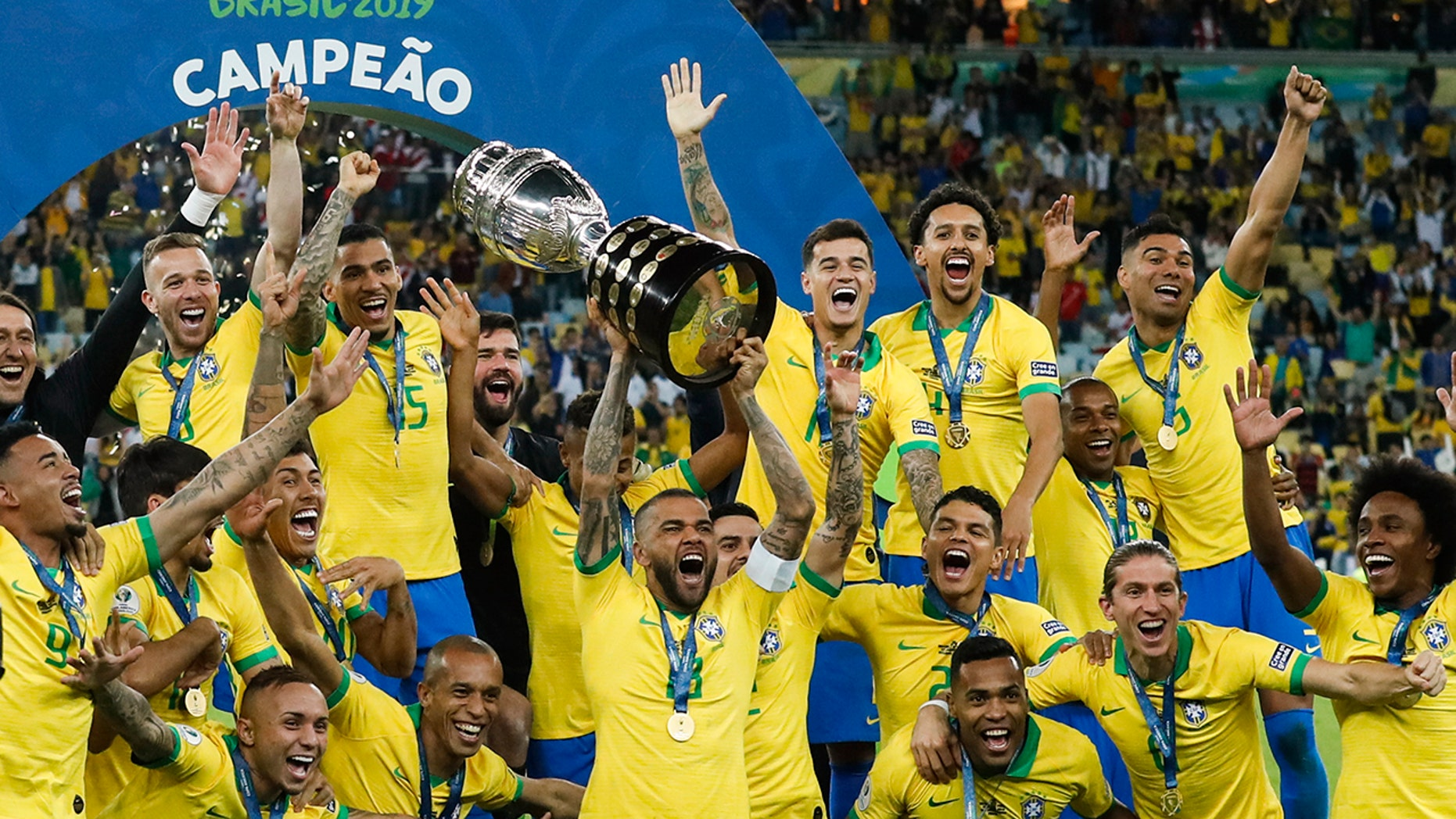 Brazil's Dani Alves rises adult his team's prize after winning a final soccer compare of a Copa America opposite Peru during a Maracana lane in Rio de Janeiro, Brazil, Sunday, Jul 7, 2019. Brazil won 3-1. (AP Photo/Victor R. Caivano)
