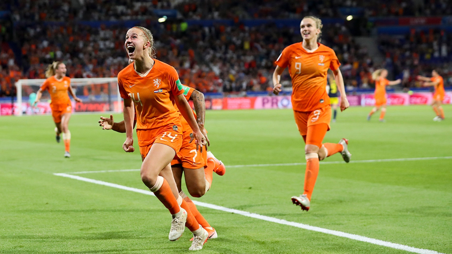 Netherlands' Jackie Groenen, foreground, celebrates after scoring during the Women's World Cup semifinal soccer match between the Netherlands and Sweden, at the Stade de Lyon outside Lyon, France, Wednesday, July 3, 2019. (AP Photo/Francisco Seco)