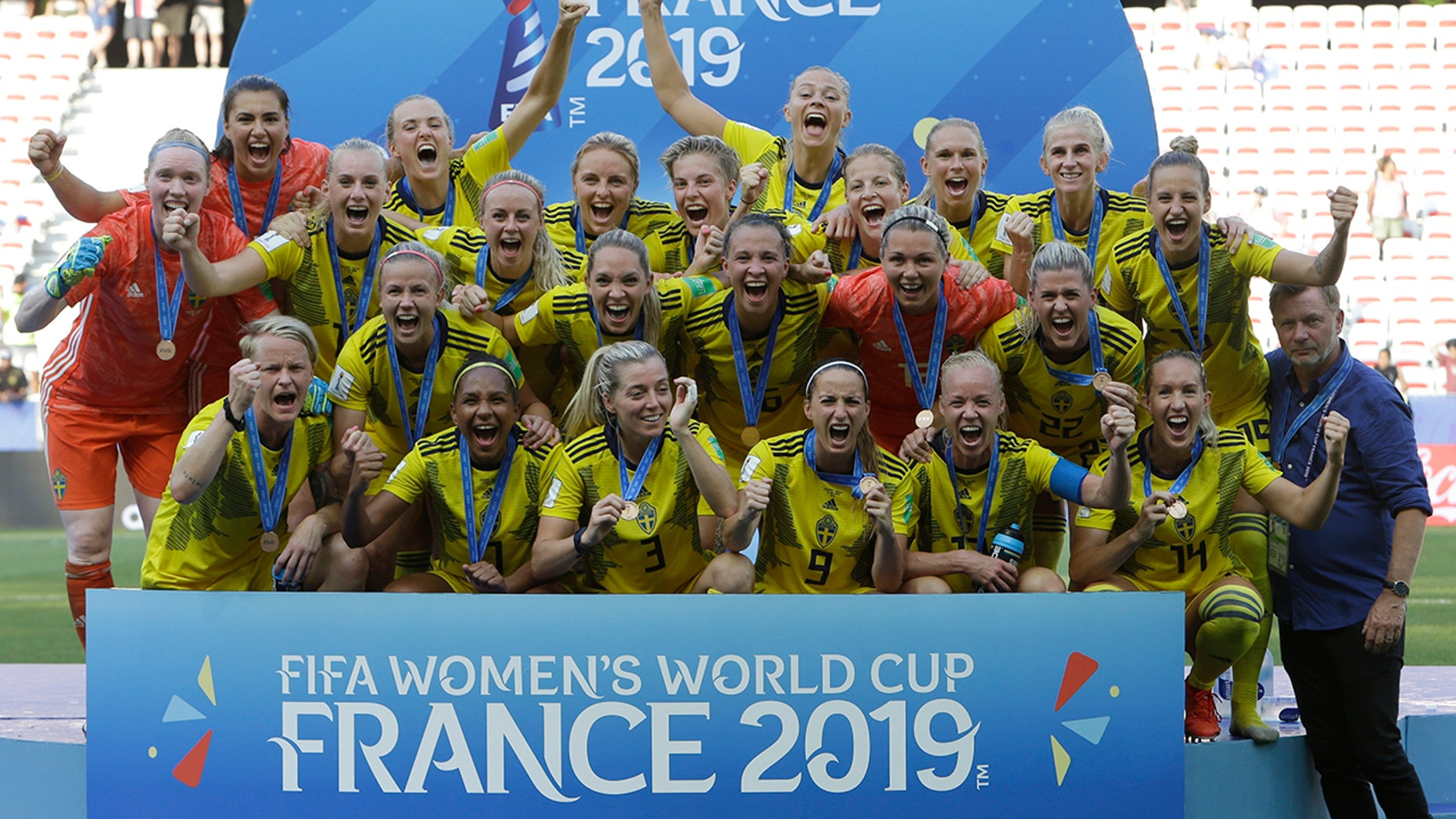 Sweden players applaud with their bronze medals after a Women's World Cup third place soccer compare between England and Sweden during Stade de Nice, in Nice, France, Saturday, Jul 6, 2019. (AP Photo/Claude Paris)