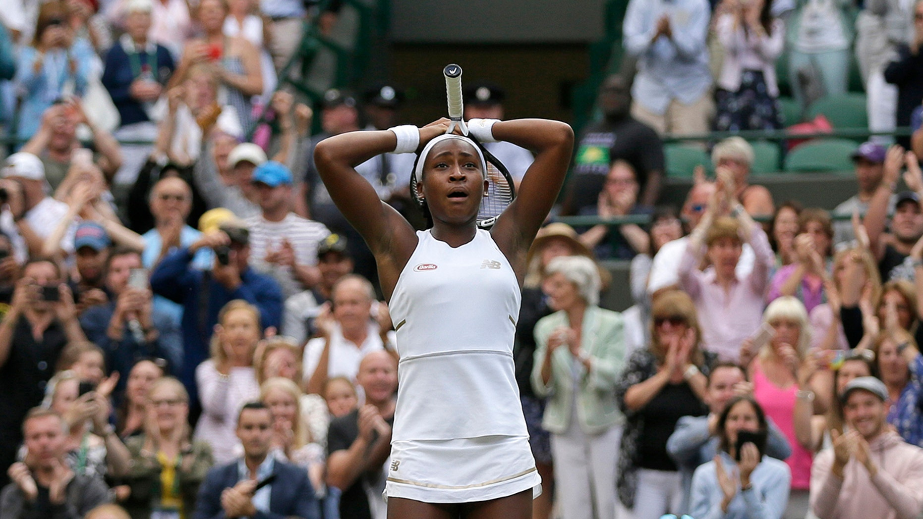"United States' Cori ""Coco"" Gauff reacts after beating United States's Venus Williams in a Women's singles match during day one of the Wimbledon Tennis Championships in London, Monday, July 1, 2019. (AP Photo/Tim Ireland)"