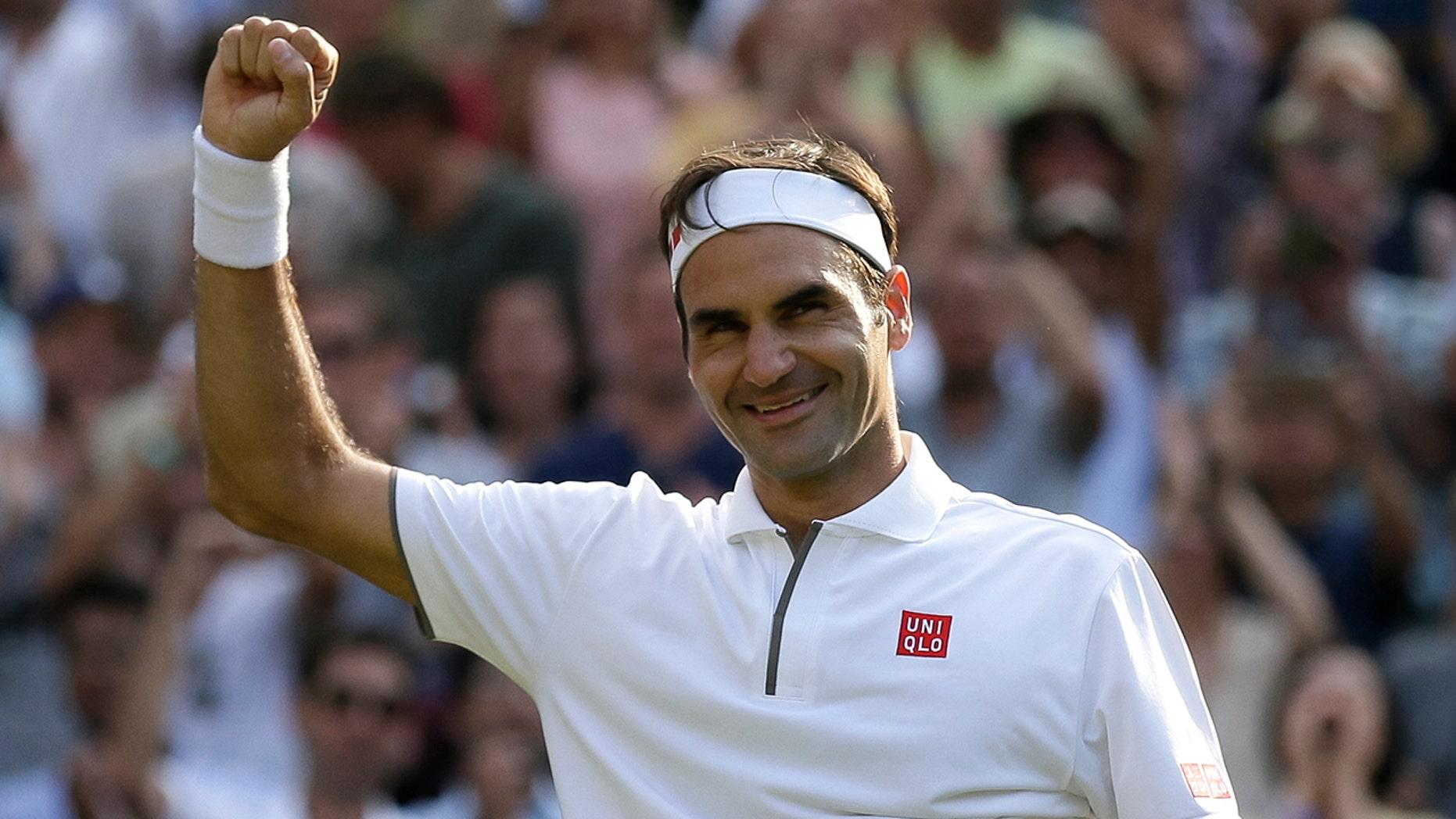 Switzerland's Roger Federer celebrates defeating Japan's Kei Nishikori during a men's quarterfinal match on day nine of the Wimbledon Tennis Championships in London, Wednesday, July 10, 2019. (AP Photo/Tim Ireland)