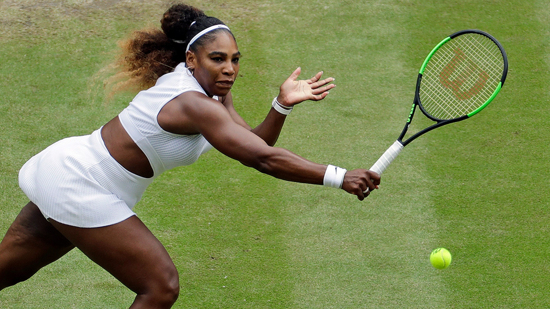 United States' Serena Williams returns to United States' Alison Riske in a Women's quarterfinal singles match on day eight of the Wimbledon Tennis Championships in London, Tuesday, July 9, 2019. (AP Photo/Ben Curtis)