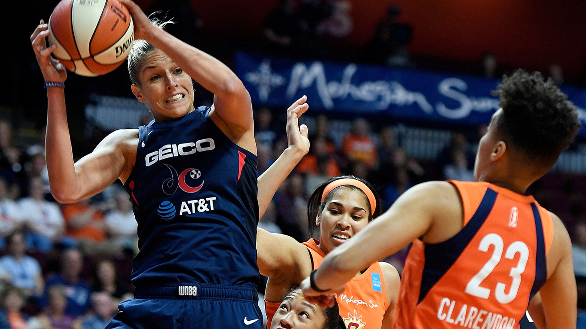 FILE - In this June 11, 2019, file photo, Washington Mystics forward Elena Delle Donne pulls down a rebound next to Connecticut Sun guard Layshia Clarendon during a WNBA basketball game in Uncasville, Conn. Thibault's squad has been using a stellar defensive effort to win five in a row and now sit atop The Associated Press WNBA power poll. The Mystics are second in the league allowing just 73.2 points a game. (Sean D. Elliot/The Day via AP, File)