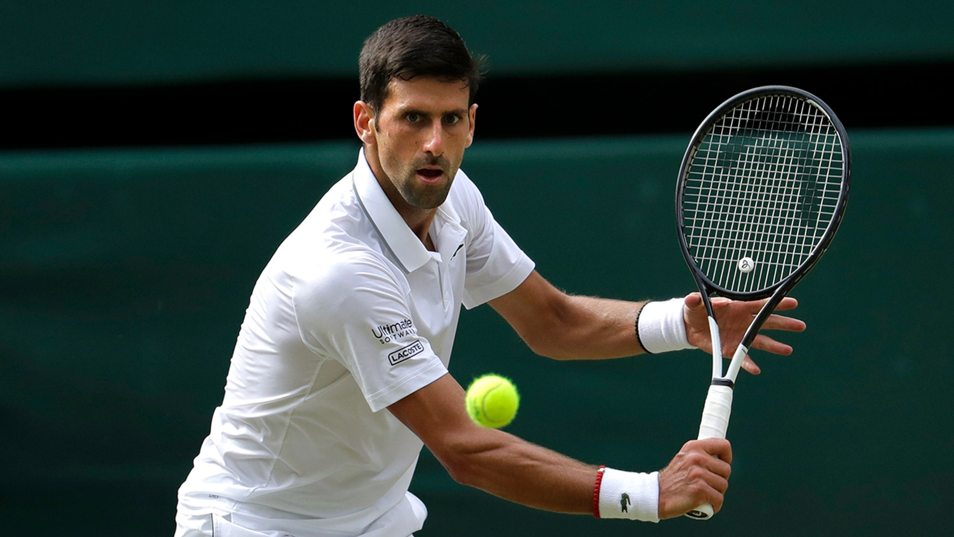 Serbia's Novak Djokovic returns the ball to Switzerland's Roger Federer during the men's singles final match of the Wimbledon Tennis Championships in London, Sunday, July 14, 2019. (AP Photo/Ben Curtis)