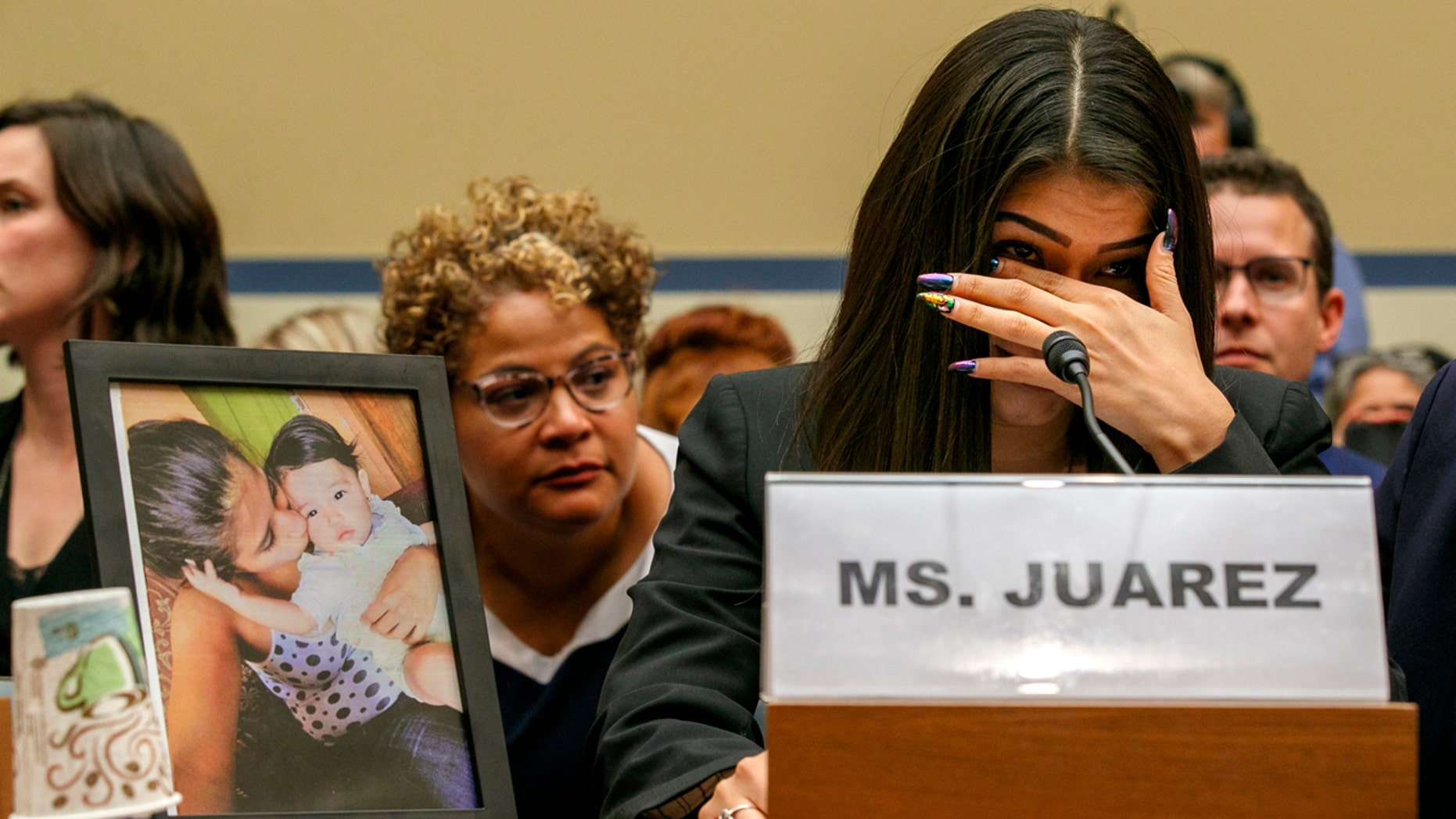 Yazmin Juárez reacts as a photo of her daughter, Mariee, who died after being released from detention by U.S. Immigration and Customs Enforcement, is placed next to her at a House Oversight subcommittee hearing on Civil Rights and Civil Liberties to discuss treatment of immigrant children at the southern border, Wednesday, July 10, 2019, on Capitol Hill in Washington. (AP Photo/Jacquelyn Martin)