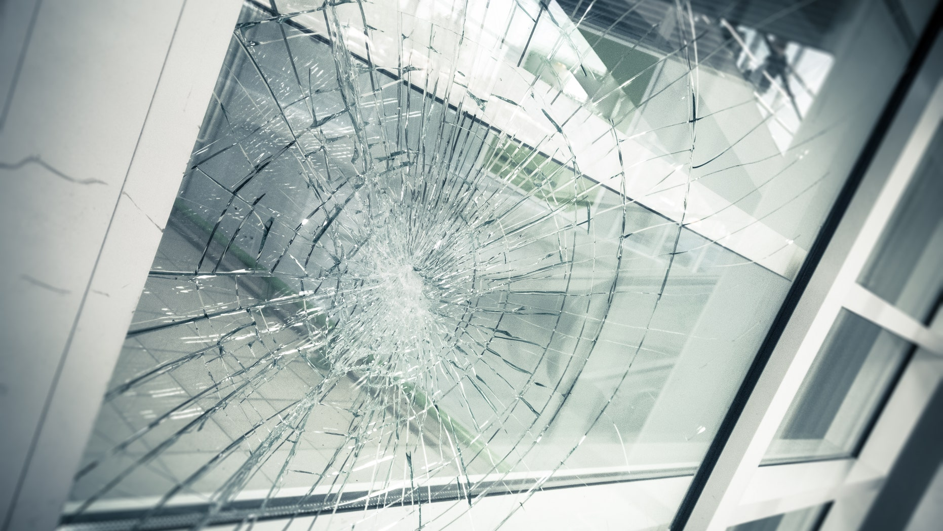 The boy said that, about four weeks earlier, he had injured his face when he crashed into a glass window after fainting.