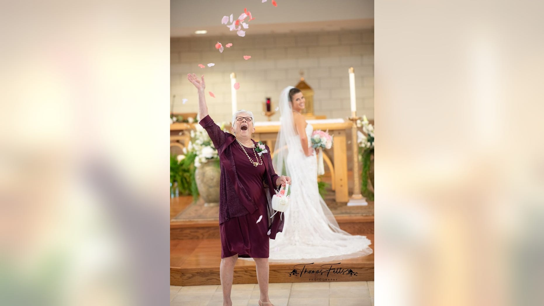 The photos, taken by Thomas Felts Photography, showed the octogenarian throwing the flower petals way up into the sky at the end of the aisle with an open-mouthed smile while the bride looks on in the background.