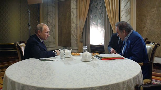 This photo taken on Wednesday, June 19, 2019, and distributed by Kremlin Press Service shows Russian President Vladimir Putin, left, during an interview with American movie director Oliver Stone for his Revealing Ukraine documentary in the Kremlin in Moscow, Russia.
