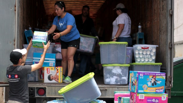 Volunteers unloading the truck of supplies at respite center in McAllen, Texas.