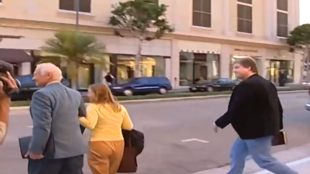Screenshot from YouTube video showing Buzz Aldrin attempting to avoid an encounter with a moon-landing conspiracy theorist.