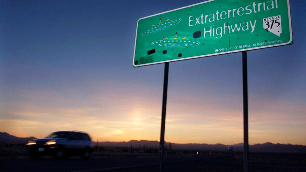 In this April 10, 2002, file photo, a vehicle moves along the Extraterrestrial Highway near Rachel, Nev., the closest town to Area 51.
