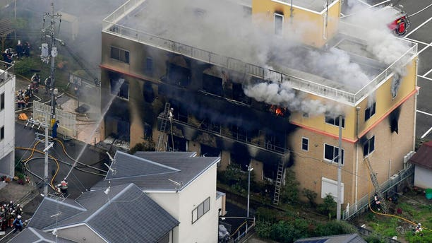 Smoke billows from a three-story building of Kyoto Animation in a fire in Kyoto, western Japan, Thursday, July 18, 2019.