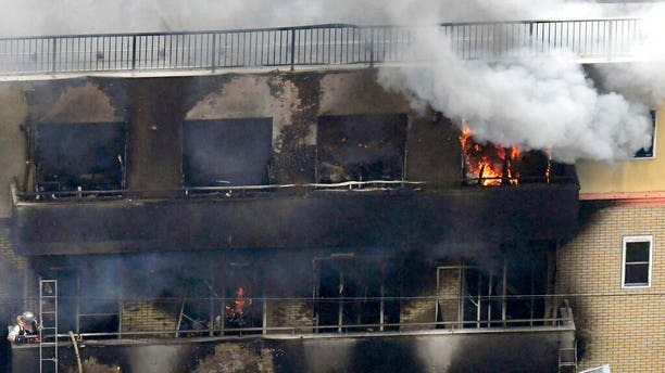 The fire broke out in the three-story building in Japan's ancient capital of Kyoto, after a suspect sprayed an unidentified liquid to accelerate the blaze, Kyoto prefectural police and fire department officials said.
