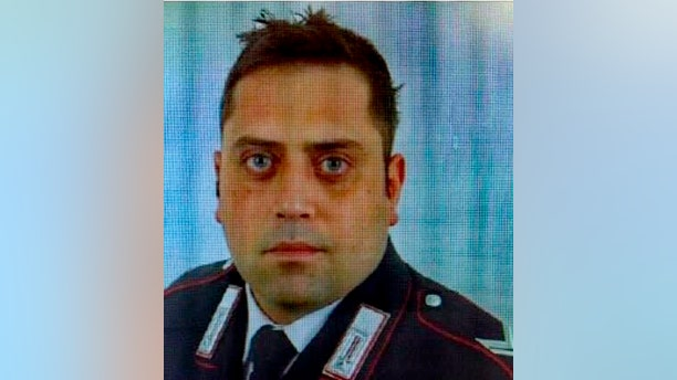 In this photo released by Carabinieri, is portrayed officer Mario Cerciello Rega, 35, who was stabbed to death in Rome early Friday, July 26, 2019. Italian police said Saturday that two 19-year-old American tourists have confessed to fatally stabbing the Italian paramilitary policeman who was investigating the theft of a bag with a cellphone.