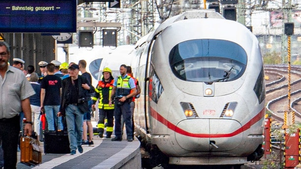 Firefighters and Police officers stay next to an ICE highspeed train at the main station in Frankfurt, Germany.