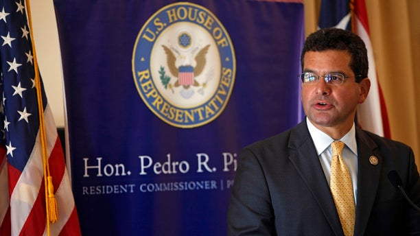 In this Sept. 24, 2013,  photo, Pedro Pierluisi, Puerto Rico's representative in Congress, speaks during a conference in San Juan, Puerto Rico.  (AP Photo/Ricardo Arduengo, File)