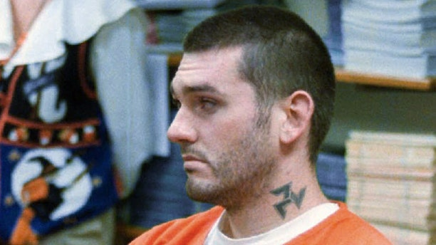 Then murder suspect Danny Lee waits for his arraignment hearing in the Pope County Detention Center in Russellville, Ark., on Friday, Oct. 31, 1997. (AP Photo/The Courier, Dan Pierce, File)