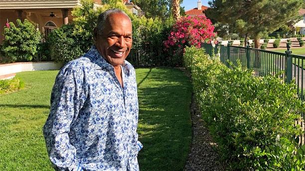 This Monday, June 3, 2019 photo provided by Didier J. Fabien shows O.J. Simpson in the garden of his Las Vegas area home. (Didier J. Fabien via AP, File)