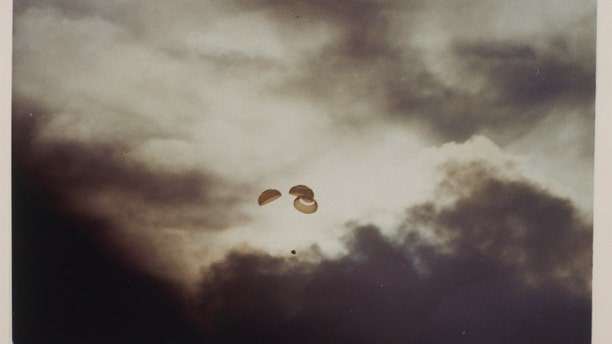 The Apollo 13 spacecraft parachutes to Earth, just before splashdown in the South Pacific Ocean after its aborted lunar landing mission, 17th April 1970. (Photo by Space Frontiers/Getty Images)