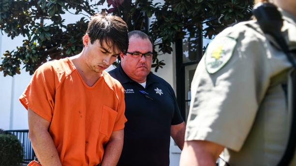 "Brandon Theesfeld, left, is led from the Lafayette County Courthouse in Oxford, Miss., Tuesday, July 23, 2019 by Maj. Alan Wilburn, after being arraigned in connection with the death of 21-year-old University of Mississippi student Alexandria ""Ally"" Kostial."