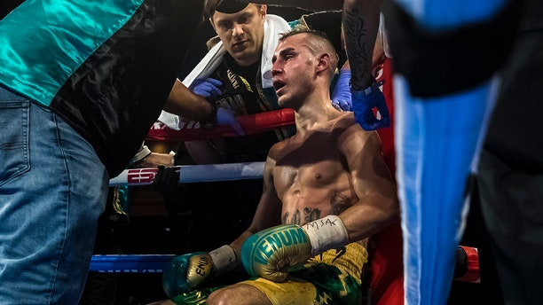 Maxim Dadashev receives attention in his corner after the eleventh round of his junior welterweight IBF World Title Elimination fight against Subriel Matias (not pictured) at The Theater at MGM National Harbor on July 19, 2019 in Oxon Hill, Maryland. His corner would throw in the towel to end the fight. (Photo by Scott Taetsch/Getty Images)