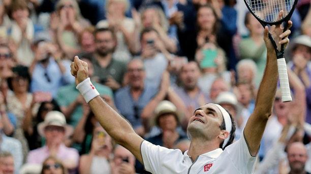 Switzerland's Roger Federer celebrates his victory. (AP Photo/Ben Curtis)