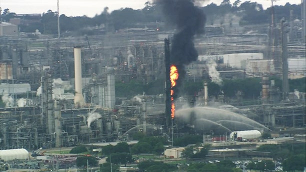 Emergency services respond to a fire at the Exxon Mobil Olefins plant in Baytown, Texas Wednesday
