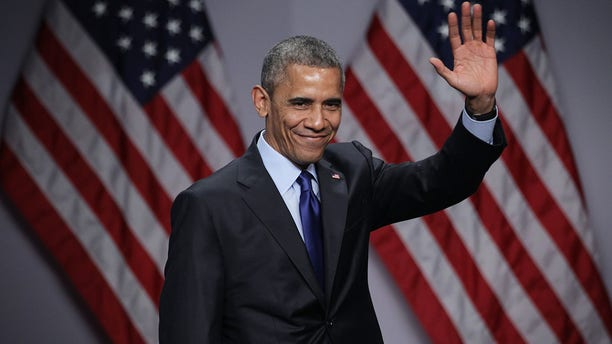 President Barack Obama waves after he spoke during the SelectUSA Investment Summit March 23, 2015, in National Harbor, Maryland. The summit brought together investors from around the world to showcase the diversity of investment opportunities available in the U.S.