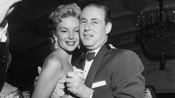 Kathleen Hughes dances with Stanley Rubin during a dinner party in Los Angeles, Calif., circa 1954. (Photo by Earl Leaf/Michael Ochs Archives/Getty Images)