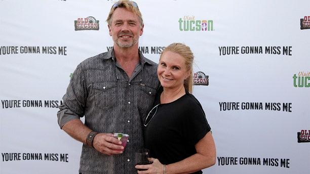 """John Schneider and Alicia Allain attend """"You're Gonna Miss Me"""" premiere sponsored by Visit Tucson on May 13, 2017 in Tucson, Ariz. (Photo by Jason Wise/Getty Images for Funimation Entertainment)"""