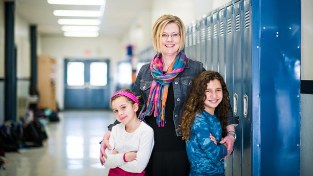 Kendra Espinoza and her daughters. Espinoza is a plaintiff in a school choice case that's made its way to the Supreme Courts. (Institute for Justice)