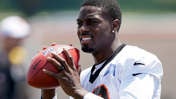 Cincinnati Bengal wide receiver A.J. Green (18) catches a pass during the first day of NFL football training camp in Dayton, Ohio, Saturday, July 27, 2019, in Dayton, Ohio. (AP Photo/Bryan Woolston)