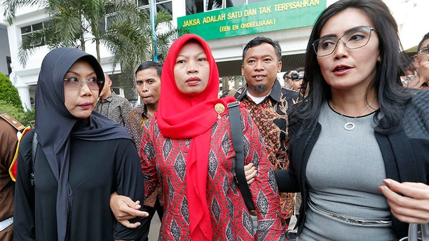 Nuril Maknun, center, arrives at the Attorney General's office in Jakarta, Indonesia, on July 12. (AP)