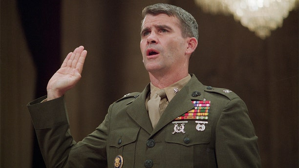 Lt. Col. Oliver North being sworn in on his first day of testimony at the Iran Contra hearings in July 1987.