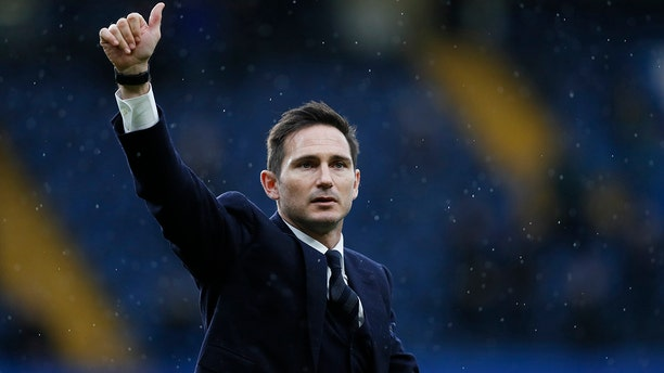 FILE - In this Saturday, Feb. 25, 2017 file photo, former Chelsea player Frank Lampard does a lap of honour at half time during the English Premier League soccer match between Chelsea and Swansea City at Stamford Bridge stadium in London. Lampard has returned to Chelsea as the club's 12th manager in 16 years under Roman Abramovich's ownership. (AP Photo/Kirsty Wigglesworth, file)