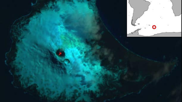 False color Landsat 8 satellite image of Saunders Island and the lava lake within the crater of the Mount Michael volcano. The image was acquired on Jan. 31, 2018. Inset map shows the location of Saunders Island in the South Atlantic. (USGS/NASA/British Antarctic Survey)