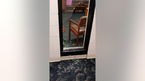 Broken glass in Seminole Heights Baptist Church after a robber broke into the church early Thursday morning. (FOX 13)